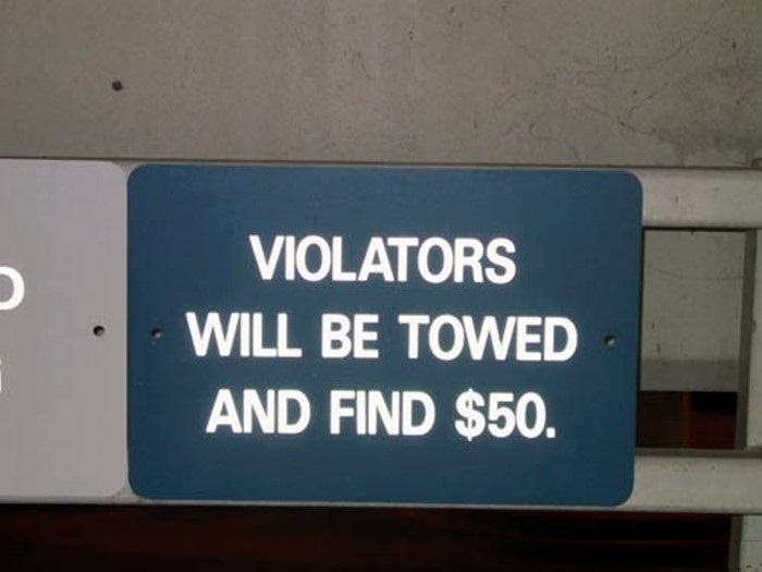 Violators will be towed and find $50